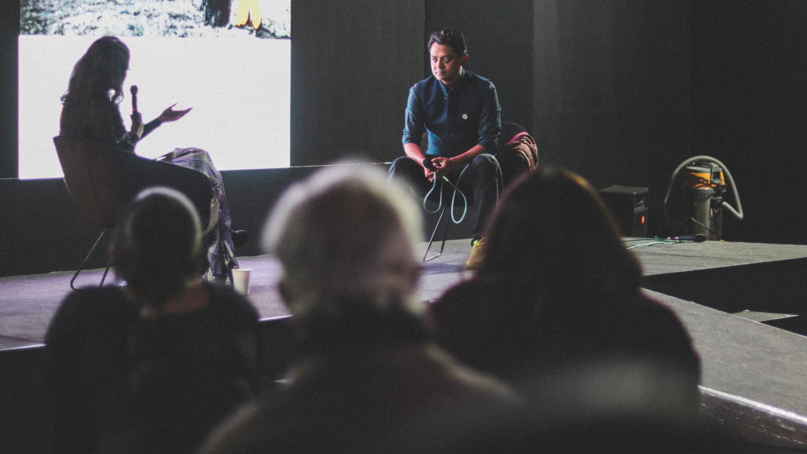 Naeem Mohaiemen discusses his work at an Auditorium Talk, 2020. Courtesy of India Art Fair